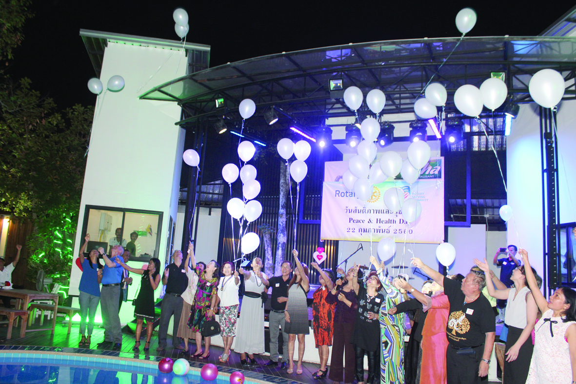Rotarians and guests release white balloons as a symbol of peace for all mankind